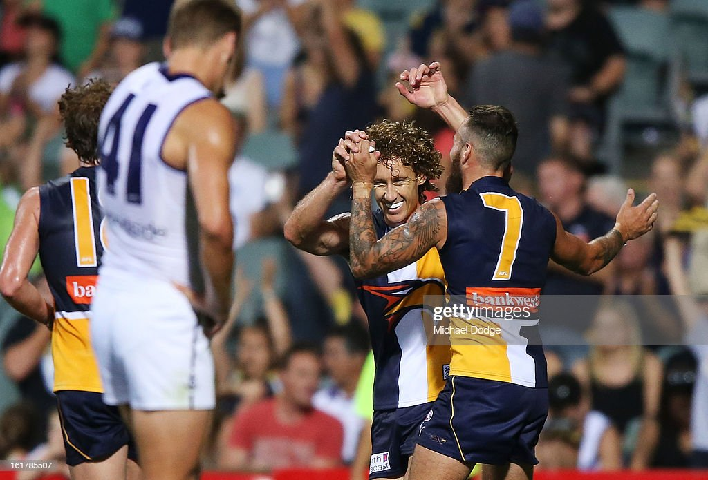 Chris Masten (R) of the West Coast Eagles celebrates their win with Matt Priddis during the round one NAB Cup match between the West Coast Eagles and the Fremantle Dockers at Patersons Stadium on February 16, 2013 in Perth, Australia.