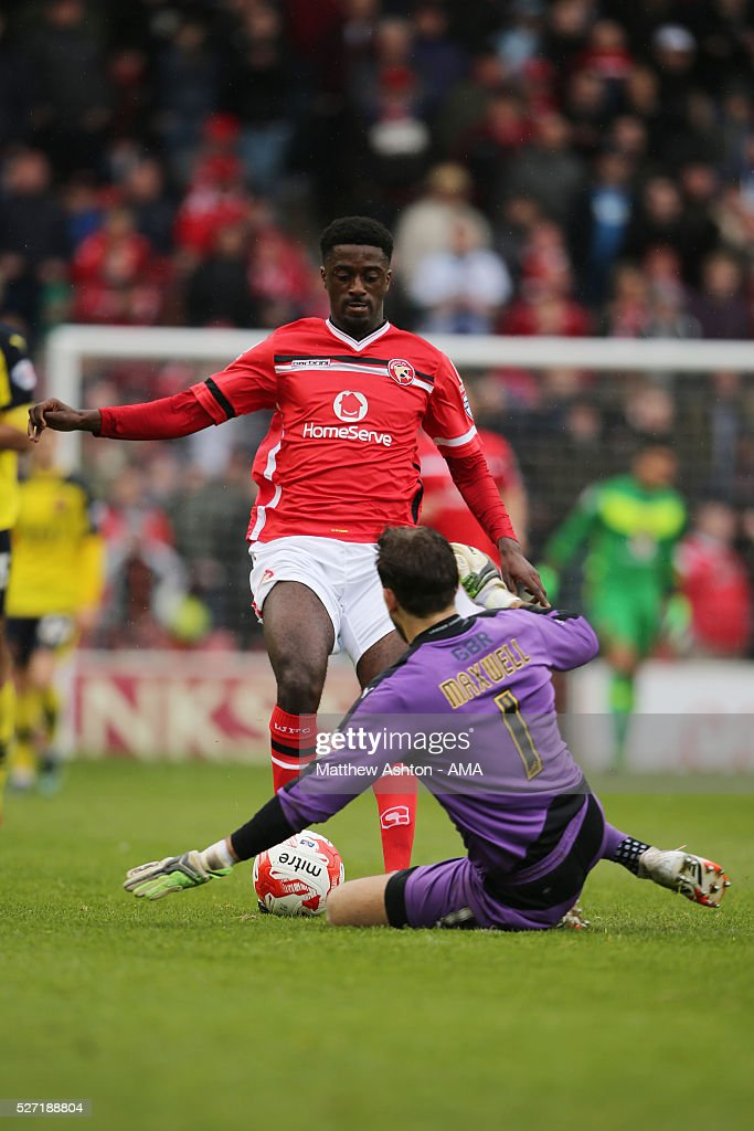 Chris Maxwell of Fleetwood Town saves from Jordy Hiwula of Walsall during the Sky Bet League One match between Walsall and Fleetwood Town at Bescot Stadium on May 2, 2016 in Walsall, England.