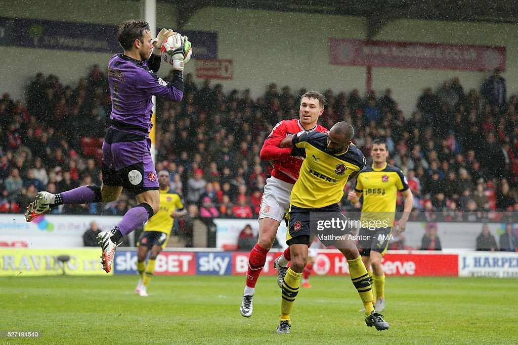 Chris Maxwell of Fleetwood Town saves from Tom Bradshaw of Walsall during the Sky Bet League One match between Walsall and Fleetwood Town at Bescot Stadium on May 2, 2016 in Walsall, England.