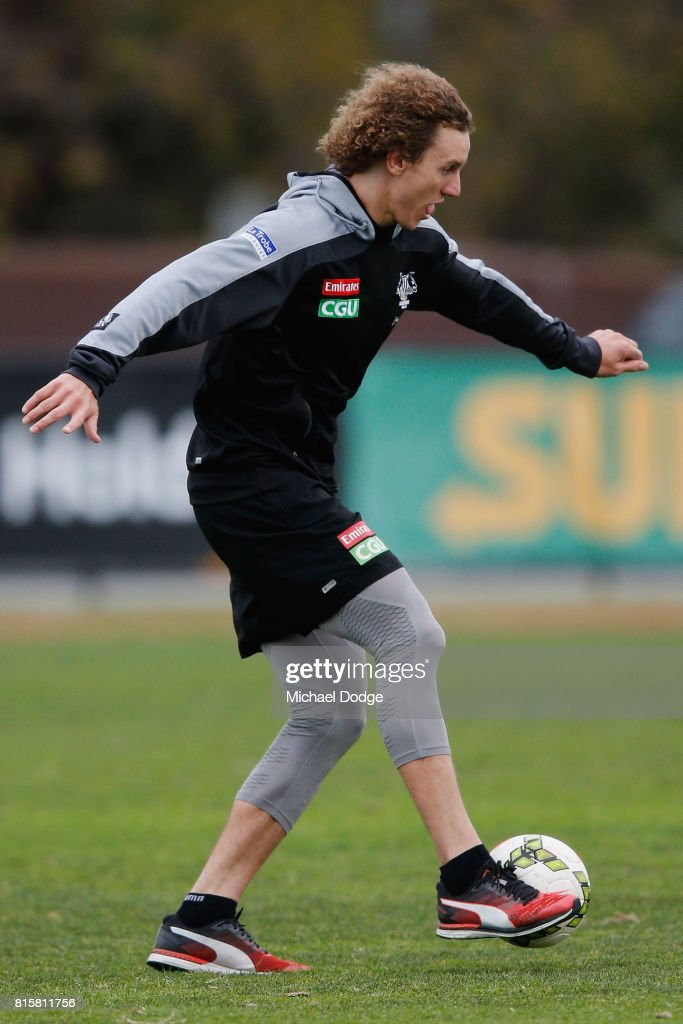 Chris Mayne lays soccer during a Collingwood Magpies AFL training session at Gosch's Paddock on July 17, 2017 in Melbourne, Australia.