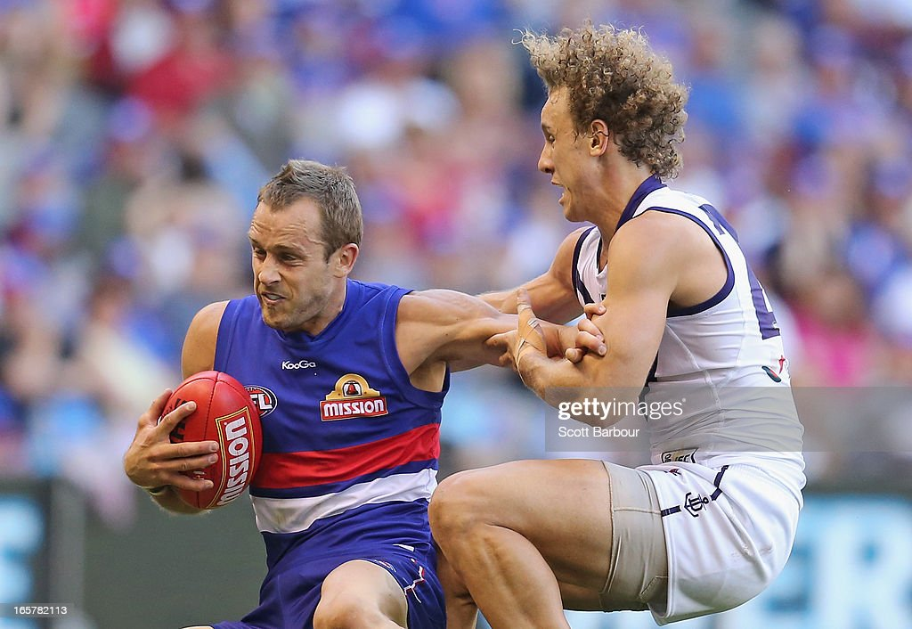 Chris Mayne of the Dockers and Daniel Cross of the Bulldogs compete for the ball during the round two AFL match between the Western Bulldogs and the Fremantle Dockers at Etihad Stadium on April 6, 2013 in Melbourne, Australia.