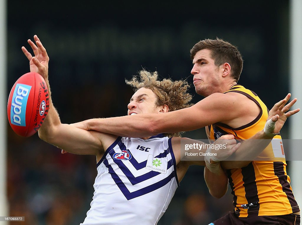 Chris Mayne of the Dockers is challenged by Ben Stratton of the Hawks during the round four AFL match between the Hawthorn Hawks and the Fremantle Dockers at Aurora Stadium on April 20, 2013 in Launceston, Australia.