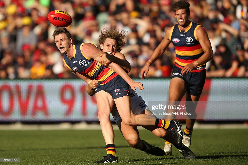 Chris Mayne of the Dockers tackles Jake Lever of the Crows during the 2016 AFL Round 06 match between the Adelaide Crows and the Fremantle Dockers at Adelaide Oval, Adelaide on April 30, 2016.