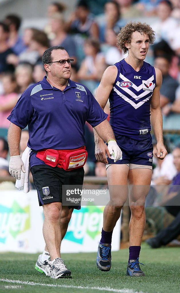 Chris Mayne of the Fremantle Dockers comes off injured during the round one NAB Cup AFL match between the Fremantle Dockers and the Geelong Cats at Patersons Stadium on February 16, 2013 in Perth, Australia.