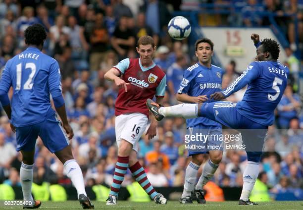 Chris McCann of Burnley passes between John Obi Mikel and Michael Essien of Chelsea