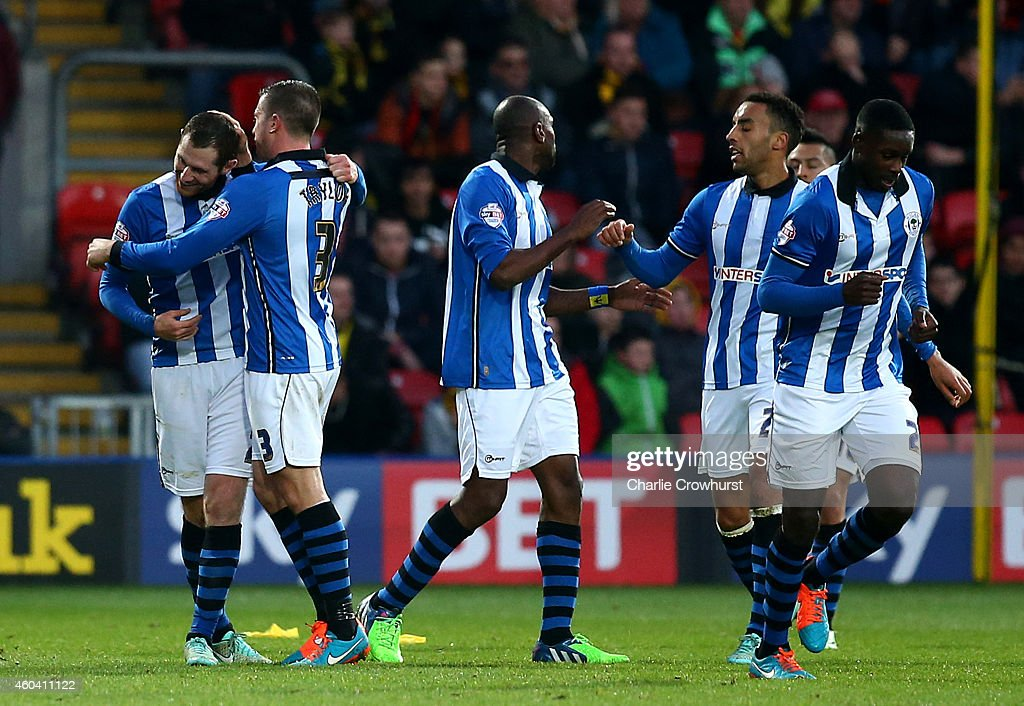 Chris McCann of Wigan celebrates with team mates after scoring the teams first goal and the equaliser during the Sky Bet Championship match between...