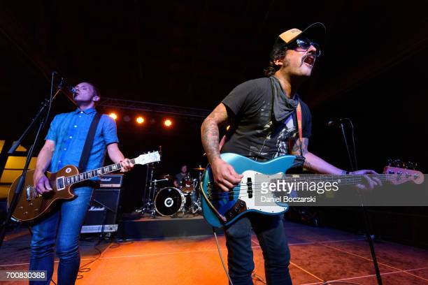 Chris McCaughan Neil Hennessy and Brendan Kelly of Lawrence Arms perform at House of Vans Chicago on June 22 2017 in Chicago Illinois