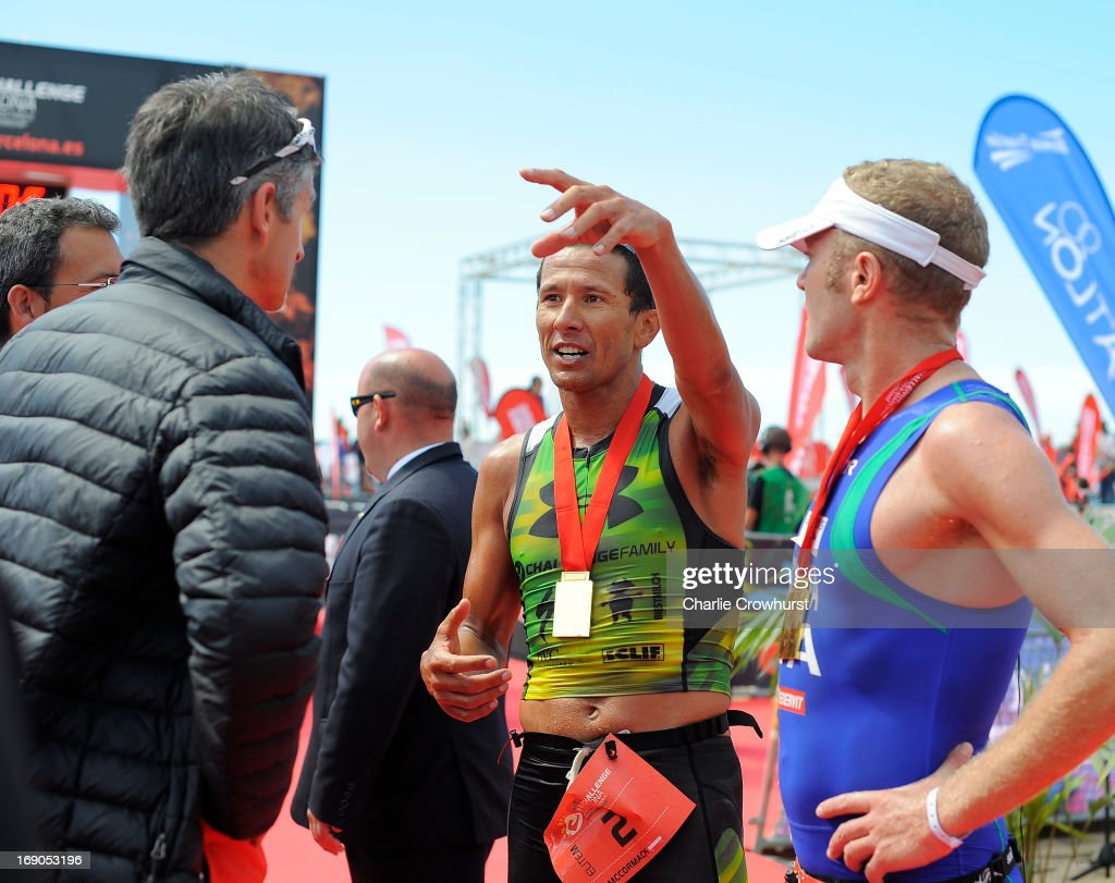 Chris McCormack of Australia chats about the course during the Challenge Family Triathlon Barcelona on May 19, 2013 in Barcelona, Spain.