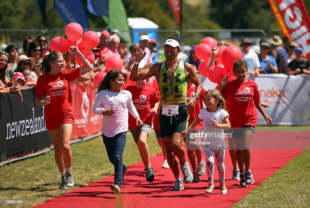Chris McCormack of Australia crosses the finish line in the Challenge Wanaka on January 19, 2013 in Wanaka, New Zealand.