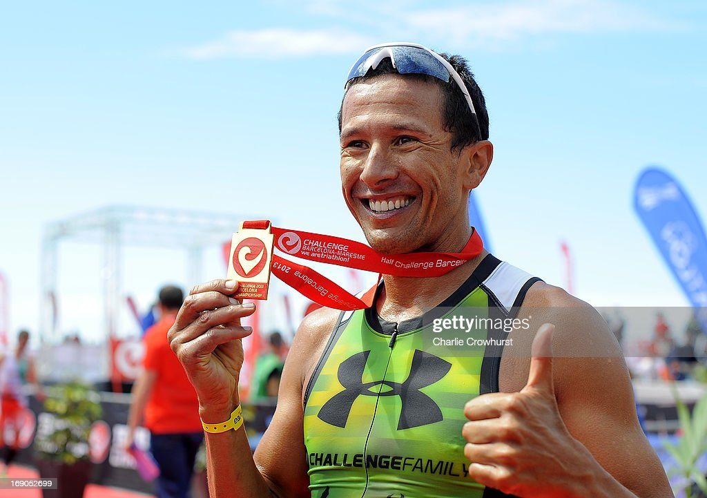 Chris McCormack of Australia poses with his medal during the Challenge Family Triathlon Barcelona on May 19, 2013 in Barcelona, Spain.