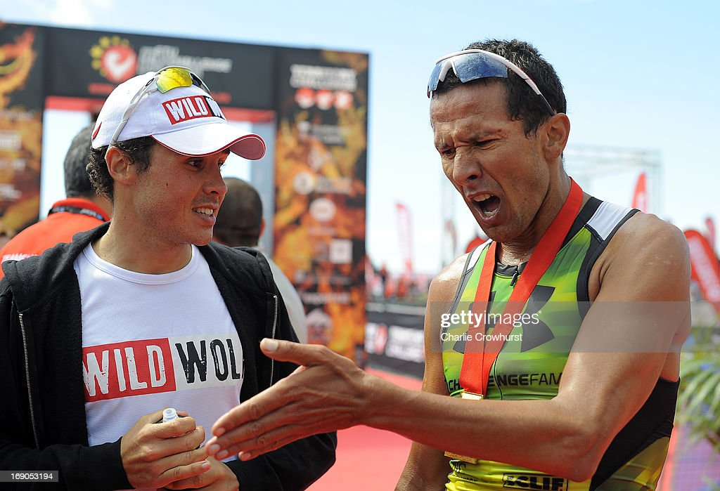 Chris McCormack (R) of Australia talks with Javier Gomez about the course during the Challenge Family Triathlon Barcelona on May 19, 2013 in Barcelona, Spain.