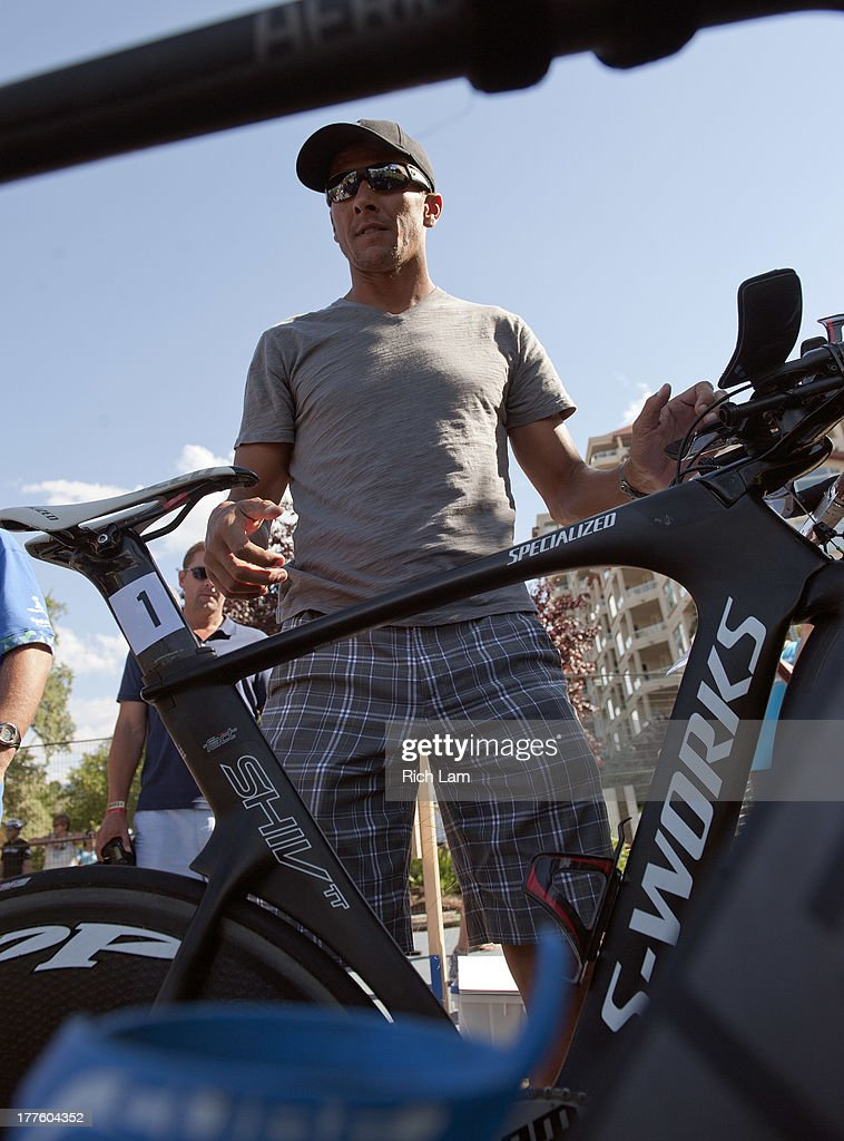 Chris McCormack of New Zealand racks his bike during the Challenge Penticton Triathlon previews on August 24, 2013 in Penticton, British Columbia, Canada.