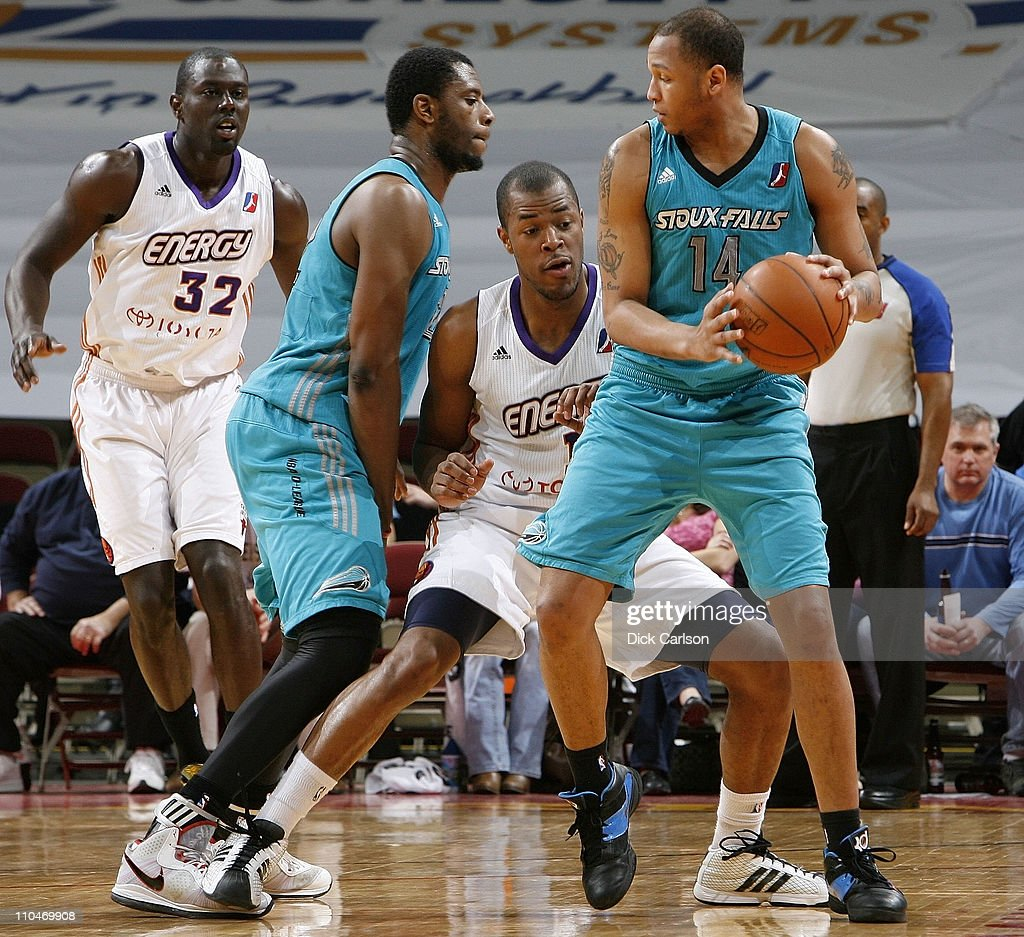 Chris McCray of the Sioux Falls Skyforce shields the ball from Marqus Blakely of the Iowa Energy as he is screened by Patrick Ewing Jr #22 of the...