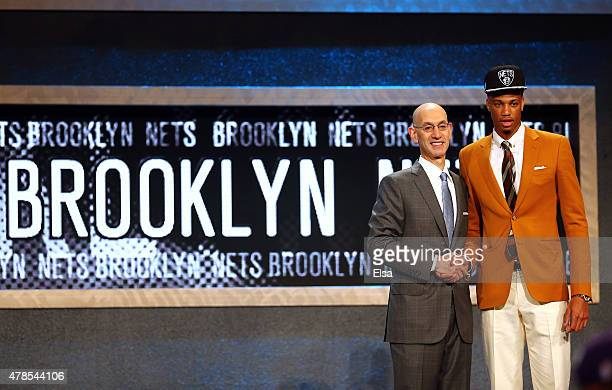 Chris McCullough meets Commissioner Adam Silver after being selected 29th overall by the Brooklyn Nets in the First Round of the 2015 NBA Draft at...