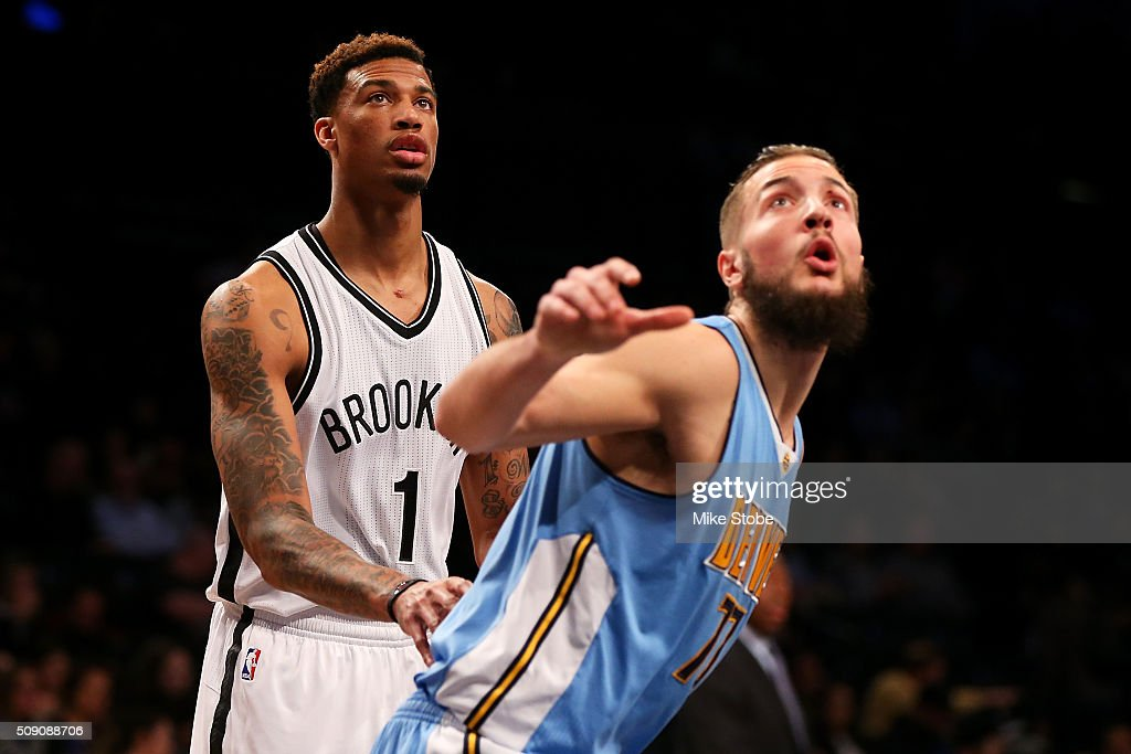 <a gi-track='captionPersonalityLinkClicked' href=/galleries/search?phrase=Chris+McCullough&family=editorial&specificpeople=13701365 ng-click='$event.stopPropagation()'>Chris McCullough</a> #1 of the Brooklyn Nets and Joffrey Lauvergne #77 of the Denver Nuggets battle for position at the Barclays Center on February 8, 2016 in Brooklyn borough of New York City.
