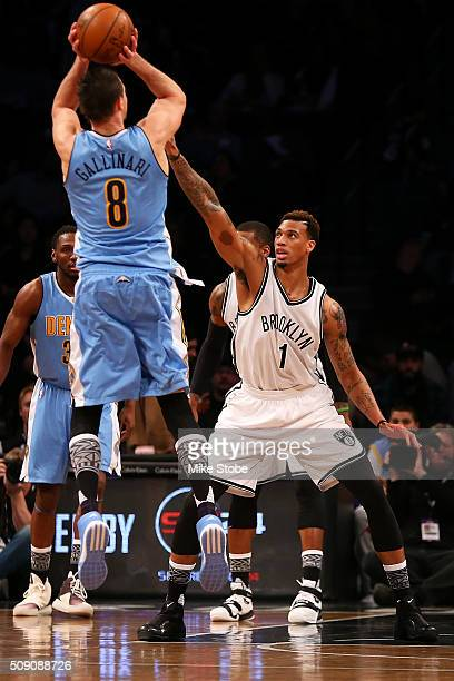 Chris McCullough of the Brooklyn Nets defends the net against Danilo Gallinari of the Denver Nuggets at the Barclays Center on February 8 2016 in...