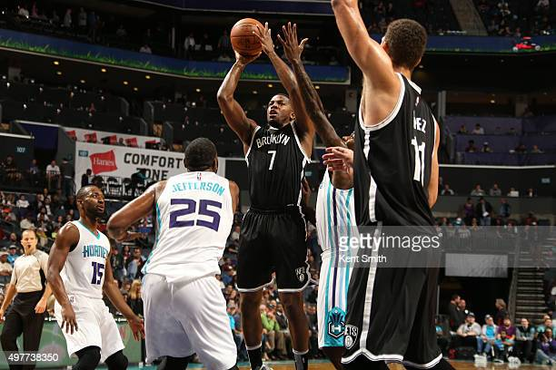 Chris McCullough of the Brooklyn Nets shoots against Al Jefferson of the Charlotte Hornets during the game at the Time Warner Cable Arena on November...
