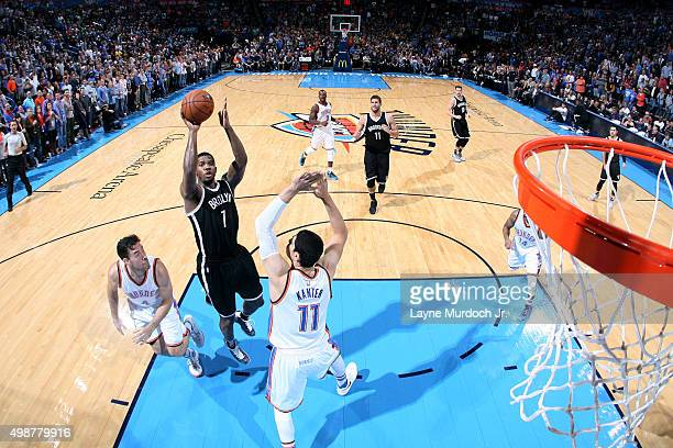 Chris McCullough of the Brooklyn Nets shoots against Enes Kanter of the Oklahoma City Thunder during the game on November 25 2015 at Chesapeake...