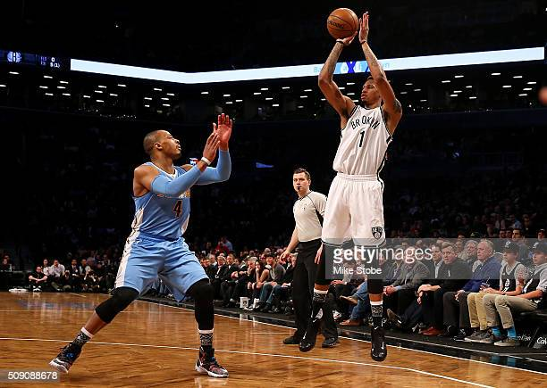 Chris McCullough of the Brooklyn Nets shoots and scores in his NBA debut against the Denver Nuggets at the Barclays Center on February 8 2016 in...