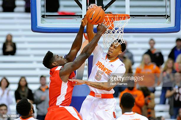 Chris McCullough of the Syracuse Orange blocks the shot of David Onuorah of the Cornell Big Red during the first half at the Carrier Dome on December...
