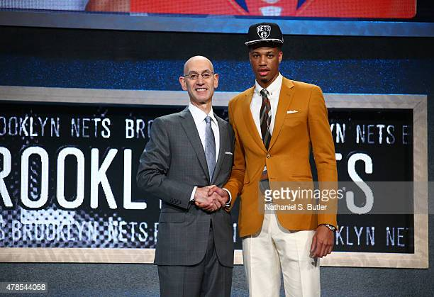 Chris McCullough shakes hands with NBA Commissioner Adam Silver after being selected number twenty nine overall by the Brooklyn Nets during the 2015...