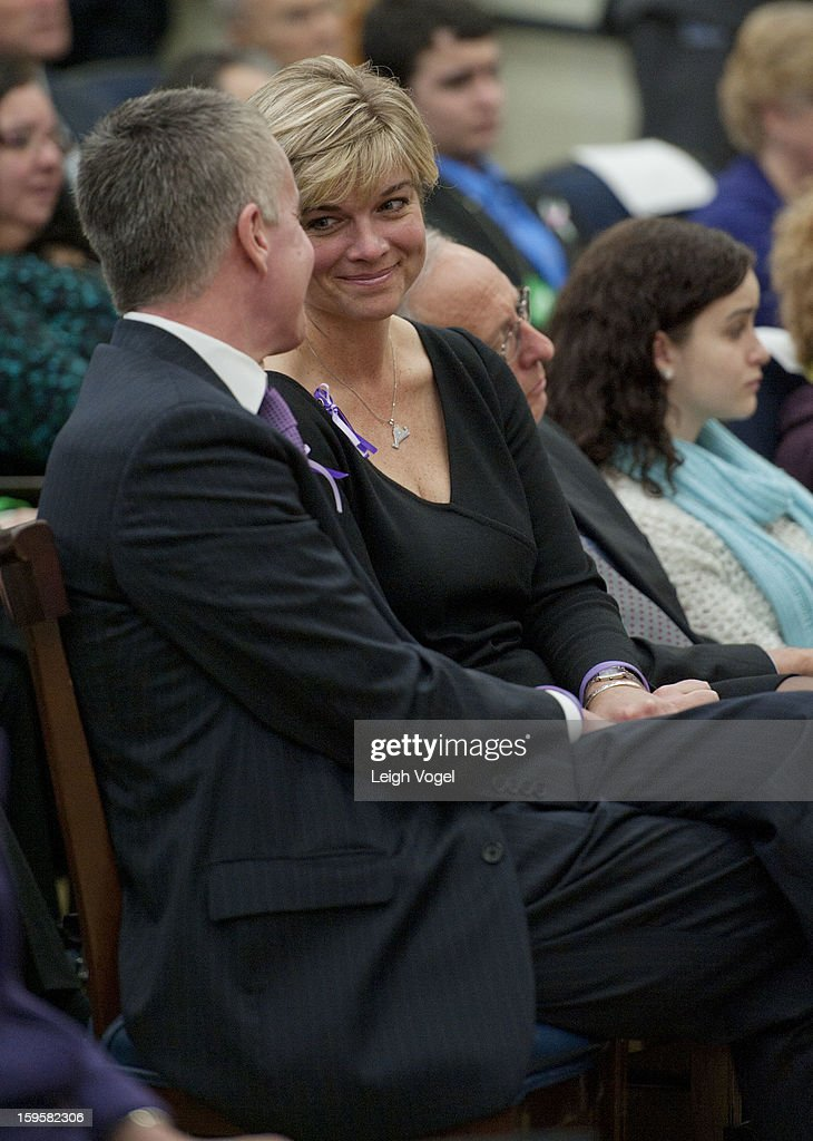 Chris McDonnell and Lynn McDonnell, parents of Sandy Hook victim, seven-year-old Grace McDonnell, attend a ceremony where President Barack Obama signs executive orders designed to reduce gun violence in the United States in the Eisenhower Executive Building on January 16, 2013 in Washington, DC.