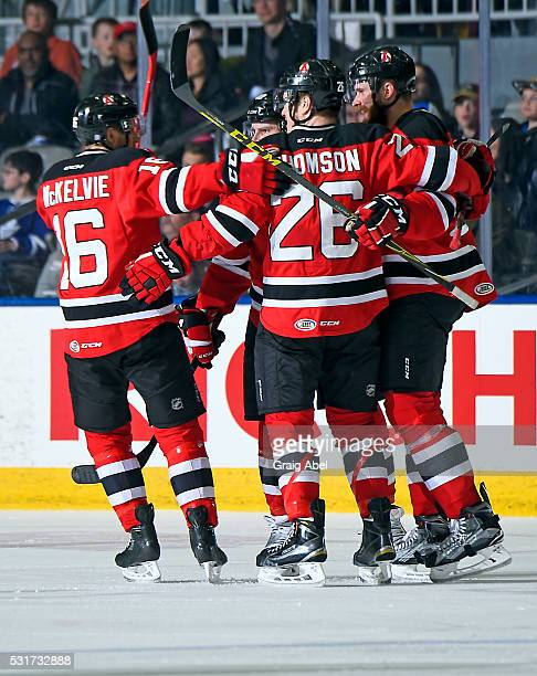 Chris McKelvie and Ben Thomson of the Albany Devils celebrate a goal with team mates against the Toronto Marlies during AHL playoff game action on...