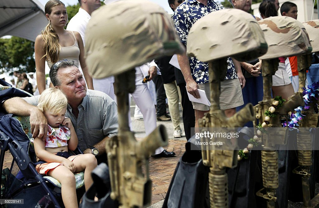 Chris McMahon, a friend of several of the Navy SEALs killed in action grieves for his friends during a memorial service held at the National Memorial Cemetery of the Pacific July 11, 2005 in Honolulu, Hawaii. The SEALs were killed during combat operations in Afghanistan on June 28.