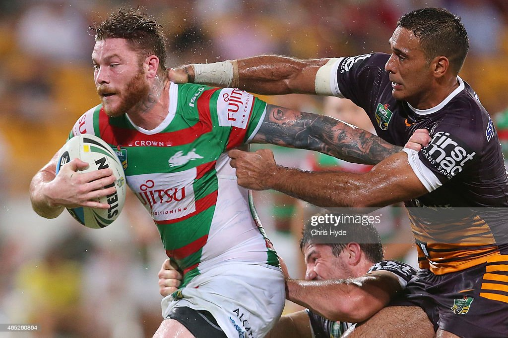 Chris McQueen of the Rabbitohs is tackled by Justin Hodges of the Broncos during the round one NRL match between the Brisbane Broncos and the South Sydney Rabbitohs at Suncorp Stadium on March 5, 2015 in Brisbane, Australia.