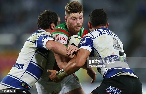 Chris McQueen of the Rabbitohs is tackled during the round 25 NRL match between the Canterbury Bulldogs and the South Sydney Rabbitohs at ANZ Stadium...