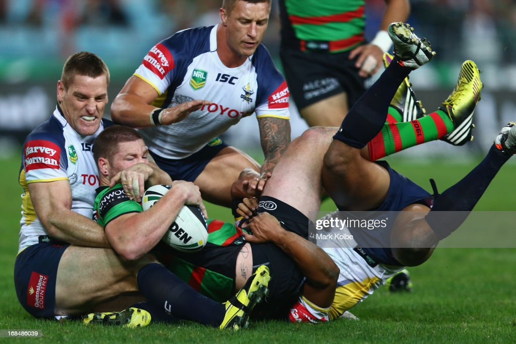 Chris McQueen of the Rabbitohs is tackled during the round nine NRL match between the South Sydney Rabbitohs and the North Queensland Cowboys at ANZ Stadium on May 10, 2013 in Sydney, Australia.