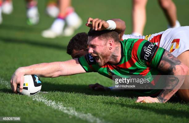 Chris McQueen of the Rabbitohs scores a try during the round 21 NRL match between the South Sydney Rabbitohs and the Newcastle Knights on August 3...