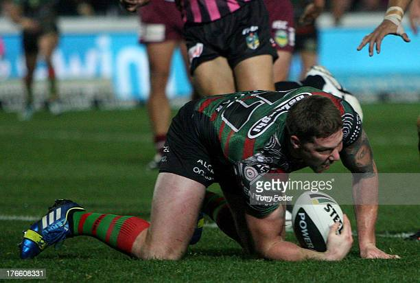Chris McQueen of the Rabbitohs scores a try during the round 23 NRL match between the South Sydney Rabbitohs and the Manly Sea Eagles at Bluetongue...