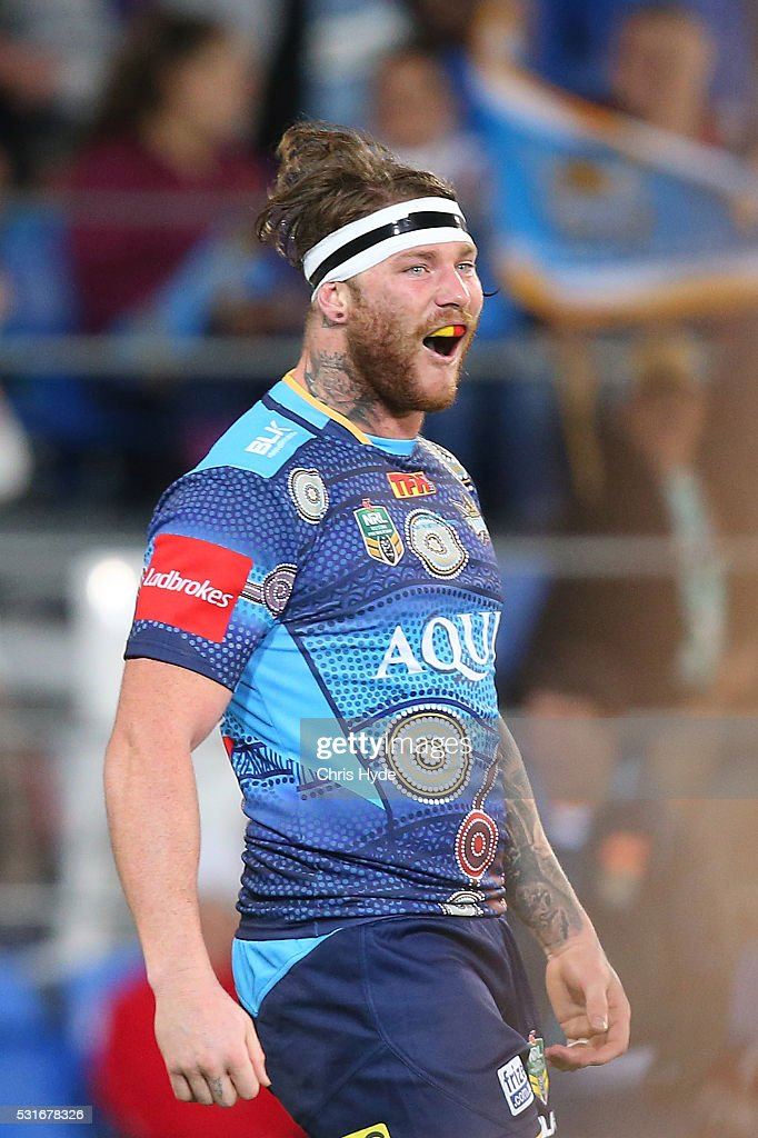 Chris McQueen of the Titans celebrates a try during the round 10 NRL match between the Gold Coast Titans and the Sydney Roosters at Cbus Super Stadium on May 16, 2016 on the Gold Coast, Australia.