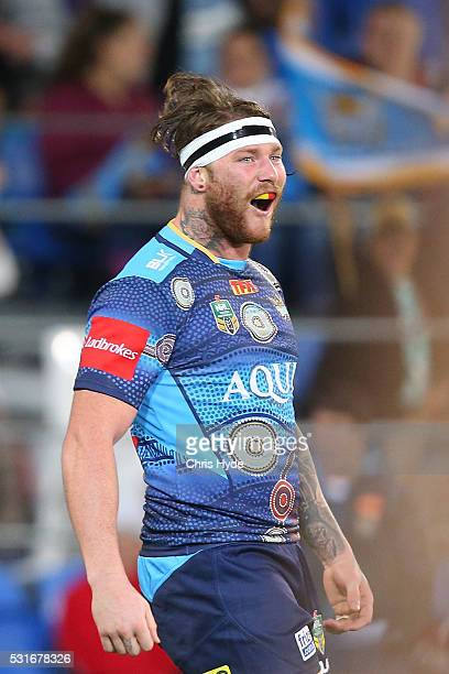 Chris McQueen of the Titans celebrates a try during the round 10 NRL match between the Gold Coast Titans and the Sydney Roosters at Cbus Super...