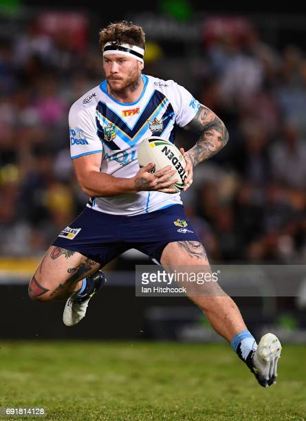 Chris McQueen of the Titans runs the ball during the round 13 NRL match between the North Queensland Cowboys and the Gold Coast Titans at 1300SMILES...