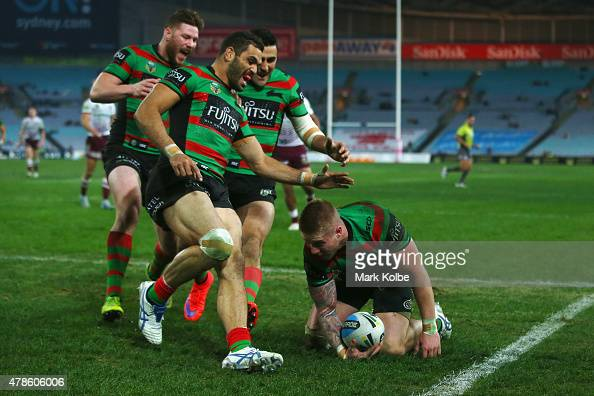 Chris McQueenGreg Inglis and Bryson Goodwin of the Rabbitohs celebrate with Aaron Gray of the Rabbitohs after he scored a try during the round 16 NRL...
