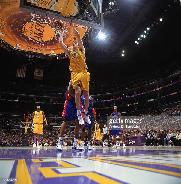 Chris Mihm of the Los Angeles Lakers dunks during a game against the Detroit Pistons at Staples Center on February 25 2005 in Los Angeles California...