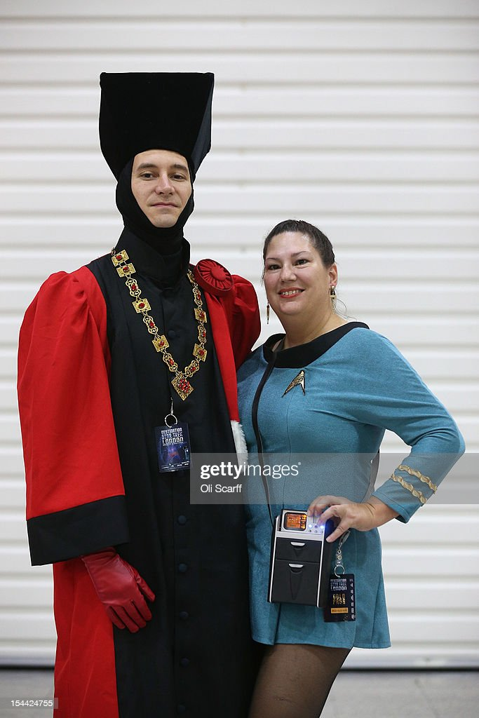 Chris Miller (L), dressed as 'Judge Q', and Brenda Havens, dressed as a Science Officer from The Original Series, arrive to attend the 'Destination Star Trek London' convention at the ExCeL centre on October 19, 2012 in London, England. The three-day convention, which opened to the general public today, will be attended by all five actors who played captains throughout the 46-year-old series.