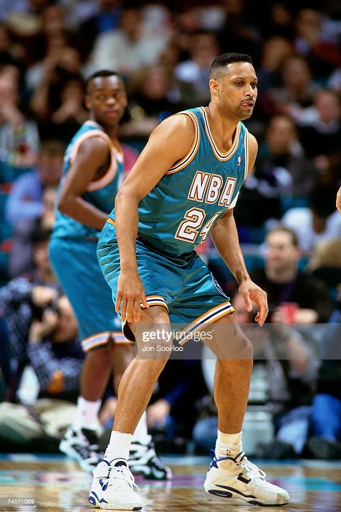 Chris Mills of the Eastern Conference digs in on defense against the Western Conference during the 1994 Shick Rookie Game played February 11 1994 at...