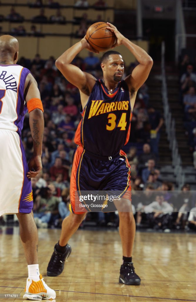 Chris Mills of the Golden State Warriors looks to pass during the NBA game against the Phoenix Suns at America West Arena on February 1 2003 in...