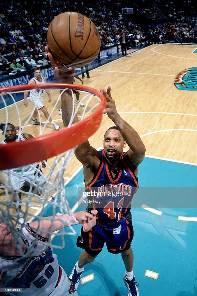 Chris Mills of the New York Knicks shoots a layup against the Vancouver Grizzlies during a game at General Motors Palace on March 27 1998 in...