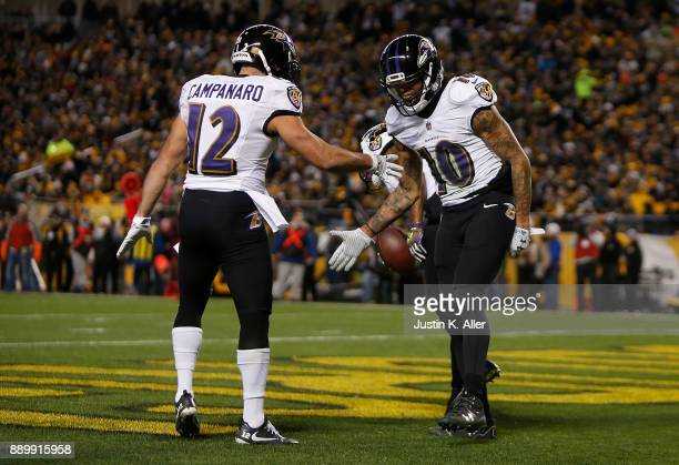 Chris Moore of the Baltimore Ravens celebrates with Michael Campanaro after a 30 yard touchdown reception in the second quarter during the game...