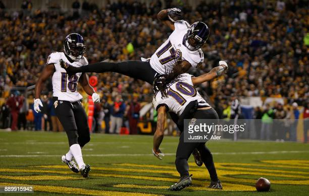 Chris Moore of the Baltimore Ravens celebrates with Mike Wallace after a 30 yard touchdown reception in the second quarter during the game against...