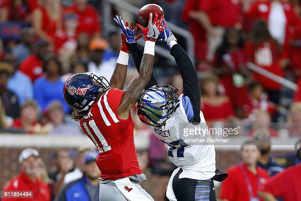 Chris Morley of the Memphis Tigers deflects a pass intended for Markell Pack of the Mississippi Rebels during the first half of a game at...