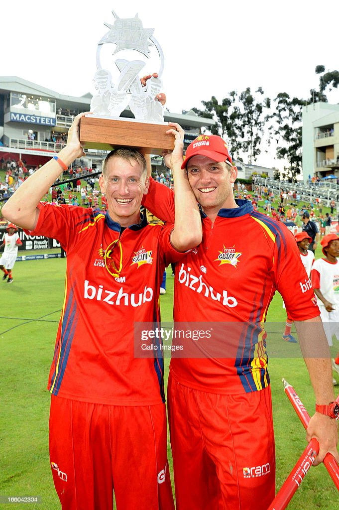 Chris Morris and Hardus Viljoen pose with the trophy during the 2013 RAM Slam T20 Challenge Final between Bizhub Highveld Lions and Nashua Titans at Bidvets Wanderers Stadium on April 07, 2013 in Johannesburg, South Africa.