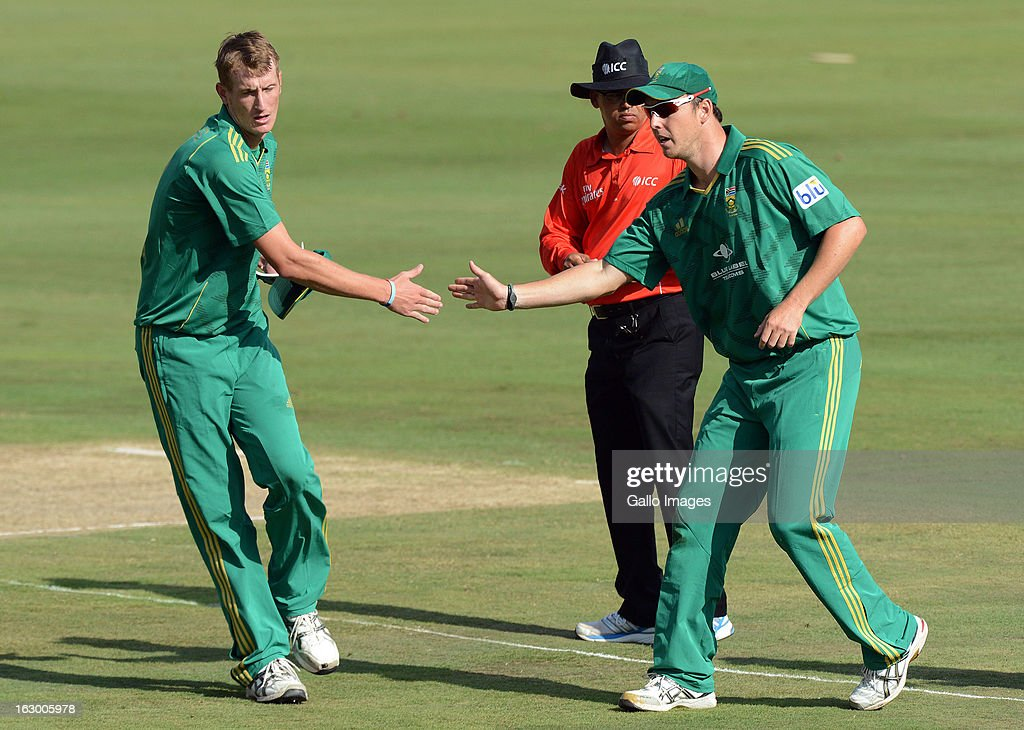 Chris Morris and Kyle Abbott of South Africa happy in the field during the 2nd T20 match between South Africa and Pakistan at SuperSport Park on March 03, 2013 in Pretoria, South Africa.