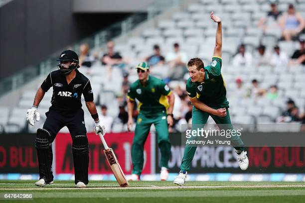 Chris Morris of South Africa bowls as Dean Brownlie of New Zealand looks on during game five of the One Day International series between New Zealand...