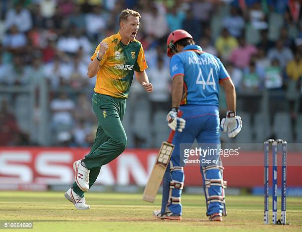 Chris Morris of South Africa celebrates dismissing Asghar Stanikzai of Afghanistan during the ICC World Twenty20 India 2016 Super 10s Group 1 match...