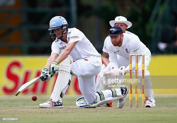 Chris Morris of South Africa plays it down to leg as wicketkeeper Jonny Bairstow of England watches on during day one of the tour match between South...